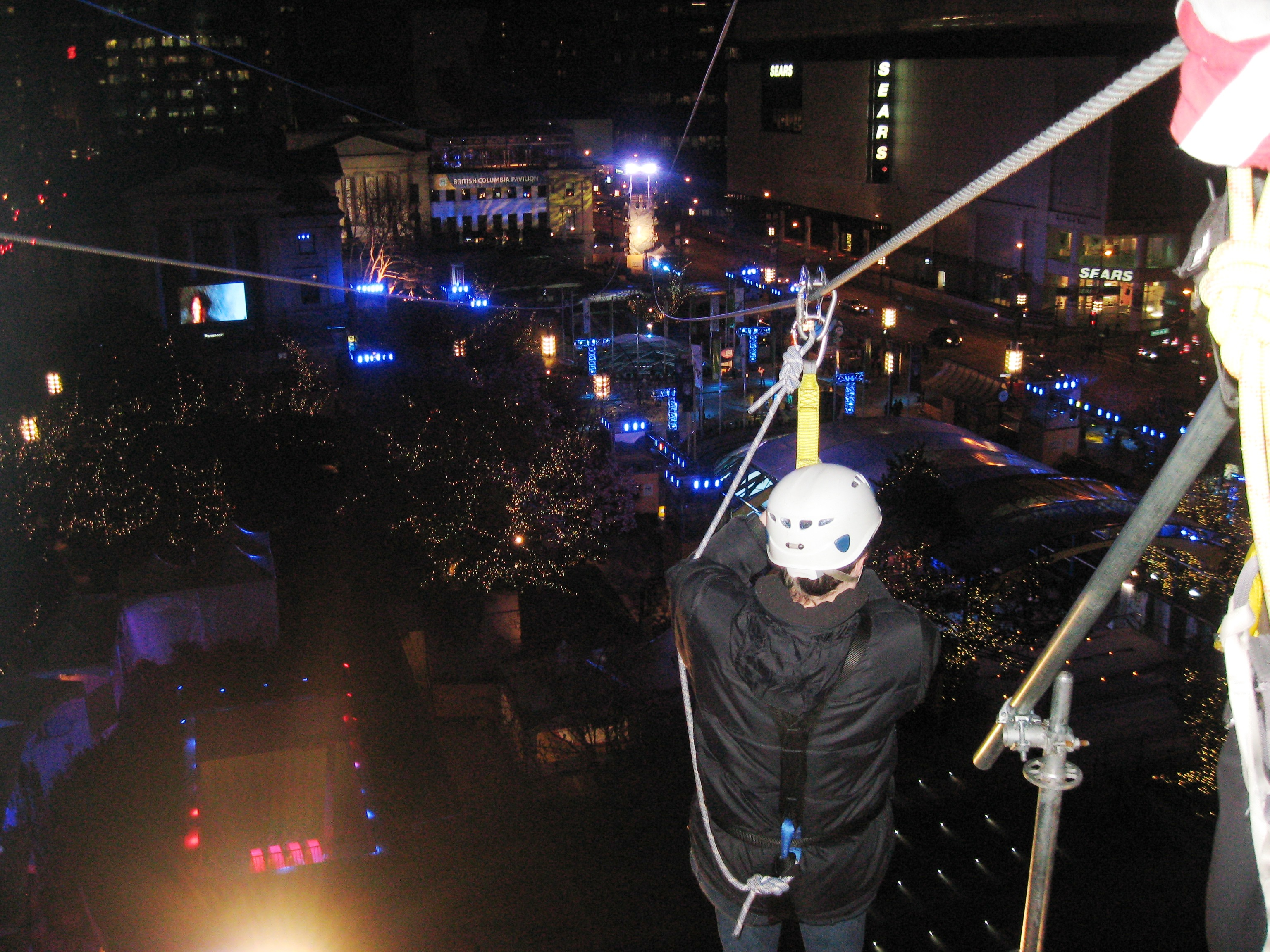 Shawn Kirkpatrick on a zipline over Robson Square